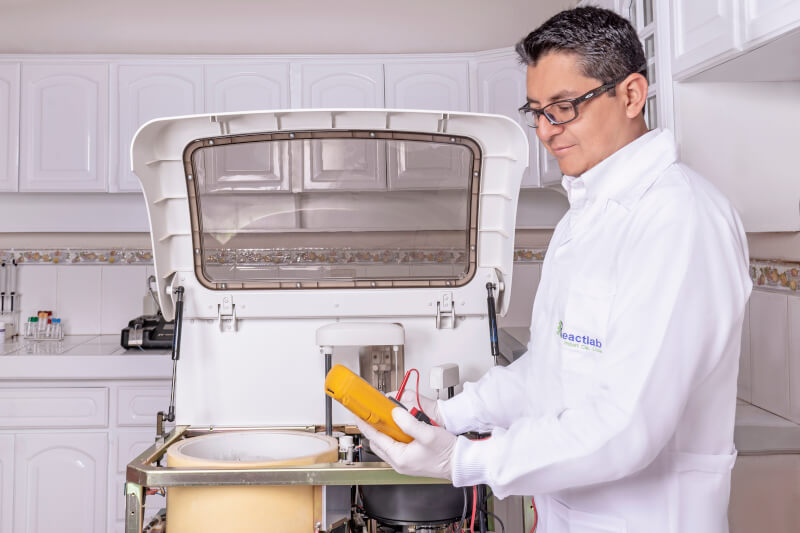 Technical support engineer doing maintenance on a clinical laboratory equipment